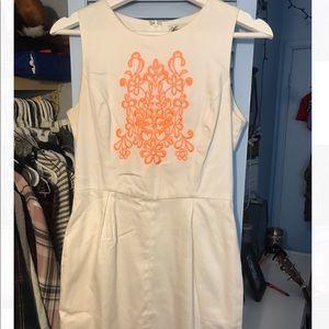 off-white dress w/orange thread design